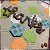 this is showcasing the dimension of both the main sentiment as well as some of the elevated hexagons and the enamel dots on the card front.