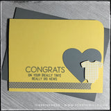 "The handmade card designed for day 33 of #the100dayproject from 1cre8ivemess, this card is the epitome of clean and simple. A yellow card base holds a die-cut grey heart and a tiny die-cut of a baby onesie that's been cut out of a gingham plaid print. The sentiment reads ""congrats on your [really tiny] really big news"" and is stamped in grey ink directly above a strip of grey washi tape that has tiny white polka dots. The upper right corner of the card base has been rounded for additional detail. A grey env"