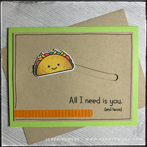 "Every taco lover out there will appreciate this handmade card! In addition to a fun sentiment, ""All I need is you. [and tacos]"" there's a smiling taco that slides back and forth across the card front! A green card base lies below the kraft panel that's elevated off of the card base to allow the taco to slide back and forth. The taco has been stamped, die-cut and colored with Prismacolor markers. A small strip of orange striped washi tape adorns the lower left portion of the kraft panel, alongside hand-drawn"