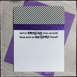 "A friendship style card with a sassy sentiment ""Isn't it amazing that we both have such an awesome friend?"" accented by a purple glittered panel next to black and white diagonally striped patterned paper. The top two corners of the card are rounded. While somewhat simplistic, the design is clean and will make any friend happy to receive."
