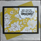 "This handmade card has a complimentary sentiment and features a regal color scheme, complete with gold accents. A black card base holds a panel of decorative patterned paper in a floral pattern with gold accents. A small white scalloped die-cut is elevated off of the card base and houses the sentiment ""Have I told you lately that you're amazing?"" which is stamped in black ink. The color of the card panel is a combination of citrine and topaz and has a true jewel tone to it. A similar colored envelope is als"