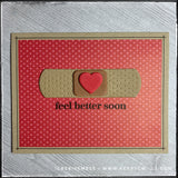 "A flat-lay view of this encouraging card. A red patterned panel with tiny, tone-on-tone polka dots covers the majority of the kraft card base. Centered on the card front is a die-cut bandaid that's made from three layers of stacked fun foam. The sentiment ""feel better soon"" is stamped in black ink under the die-cut. The blank ink coordinates the hand drawn lines that surround the perimeter of the patterned paper panel."