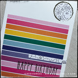 "An up close view of the colorful details on the front of this birthday card. Horizontal stripes run sideways and ""happy birthday"" is stamped in black ink over the top of them. A circle with a linear black floral pattern is near the top right corner of the card with a stamped circle around it."