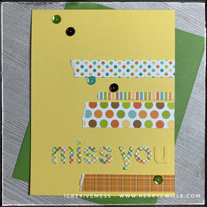"Coordinating colors and a mix of geometrical patterns add detail to this handmade card with a miss you sentiment. The words ""miss you"" have been die-cut from plaid patterned paper and four additional strips have been stacked to add detail. Patterns on the strips include stripes, plaid, and polka dots in two sizes. One end of the patterned strips has been purposely torn. A smattering of colored sequins add a little dimension. A green envelope is layered beneath the card and is included."