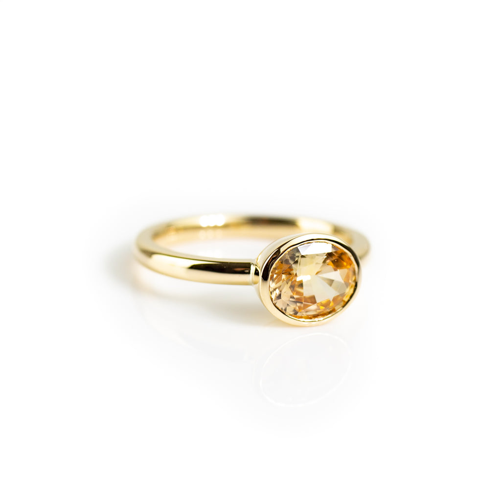 Yellow sapphire bezel set ring in yellow gold by Tamahra Prowse