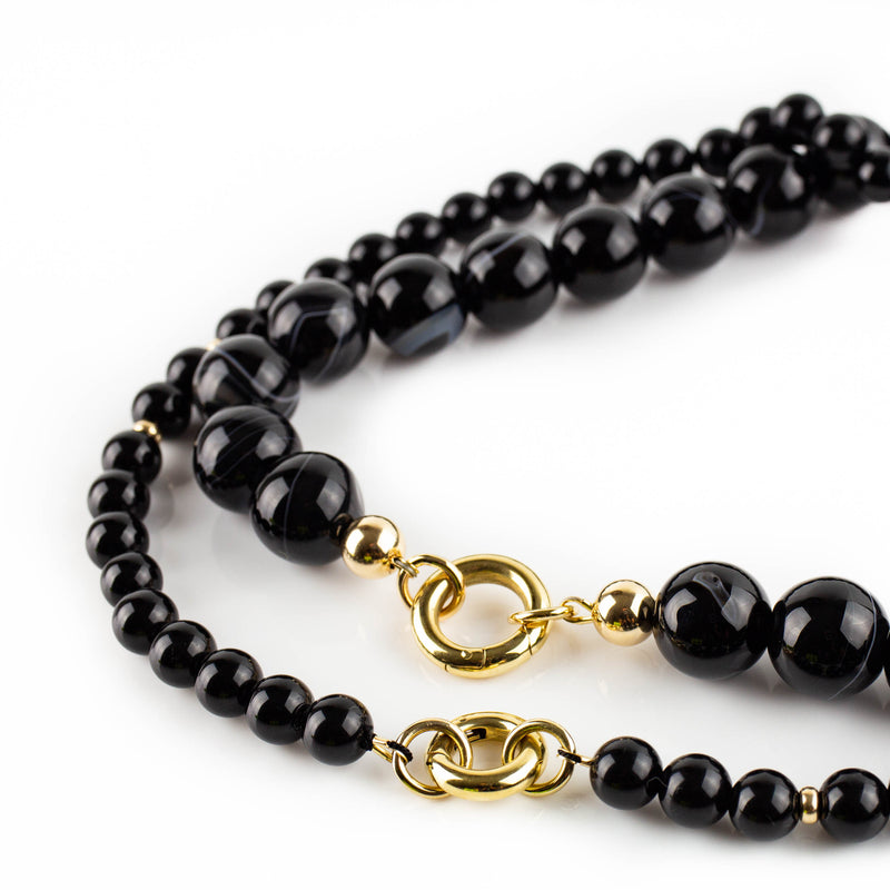 Polished onyx necklace with solid gold accents by Tamahra Prowse