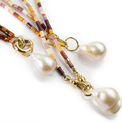 Simple baroque pearl pendant with large gold loop  by Tamahra Prowse.