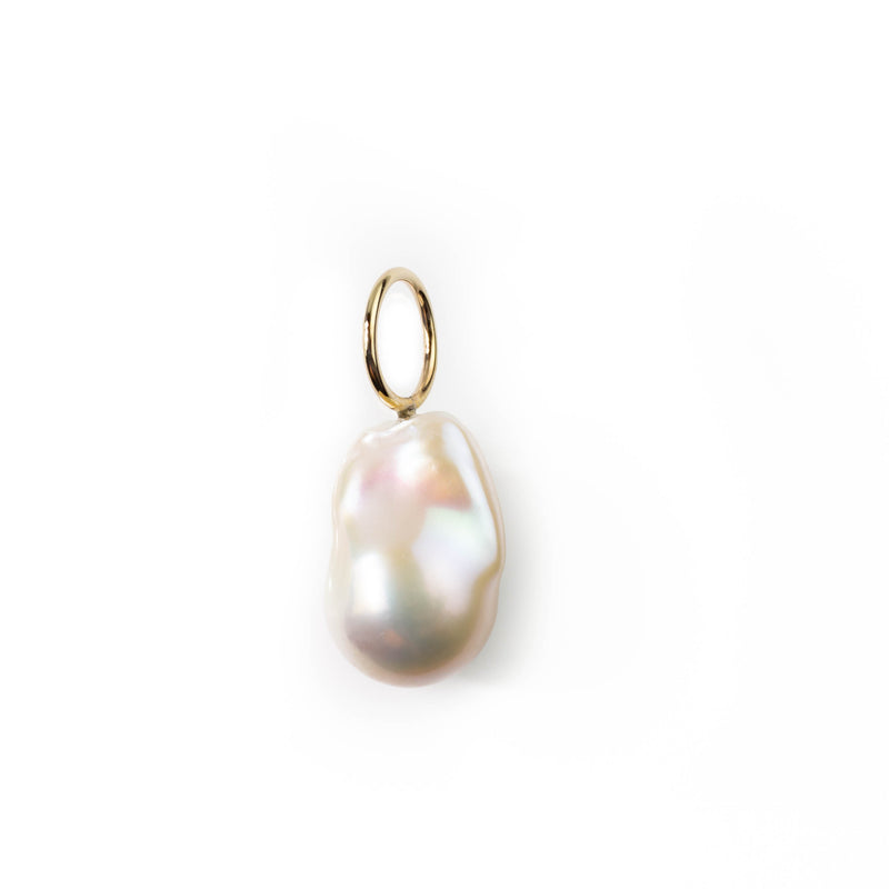 Baroque pearl pendant with simple large gold loop in 9 karat gold. By jeweller Tamahra Prowse.