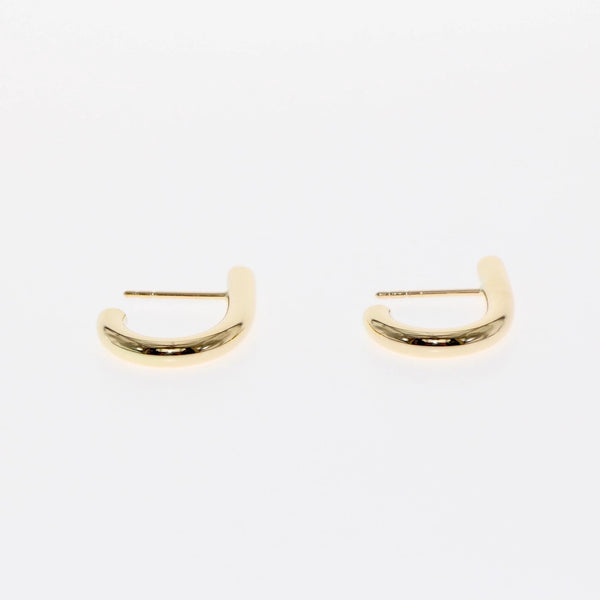 J earrings by Tamahra Prowse. Gold with a punk edge.