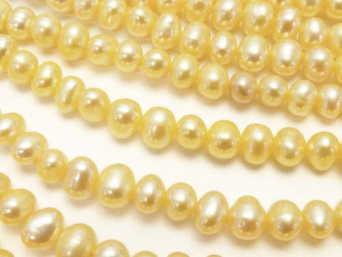 1strand $8.79! Fresh Water Pearl AAA--AA ++ Potato 4-5mm Pastel Yellow 1strand (aprx.15inch / 36cm)