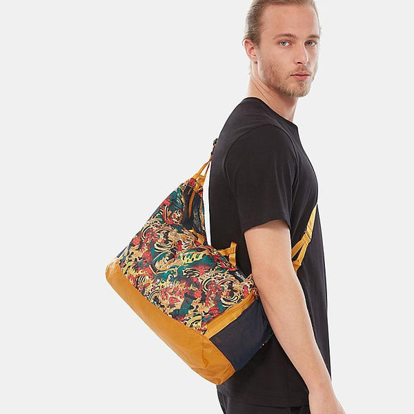 The North Face Flyweight Duffel | LEOPARD YELLOW GENESIS PRINT/CITRINE YELLOW
