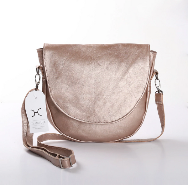 Thandana Saddle Metallic Leather Handbag | Champagne - KaryKase