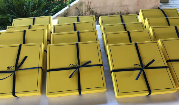 Yellow boxes with navy ribbon