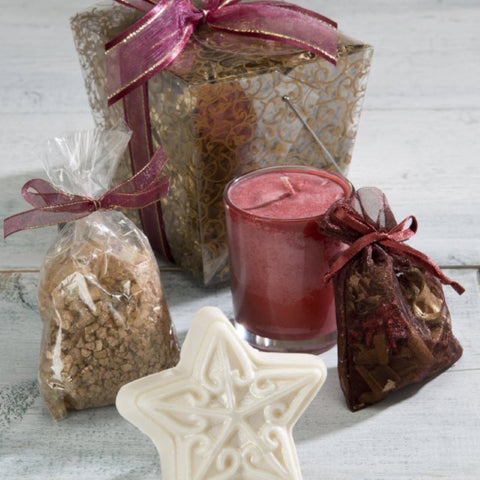 Collection of Holiday Gifts in a take out box with a candle, star soap, sachet and bath salts