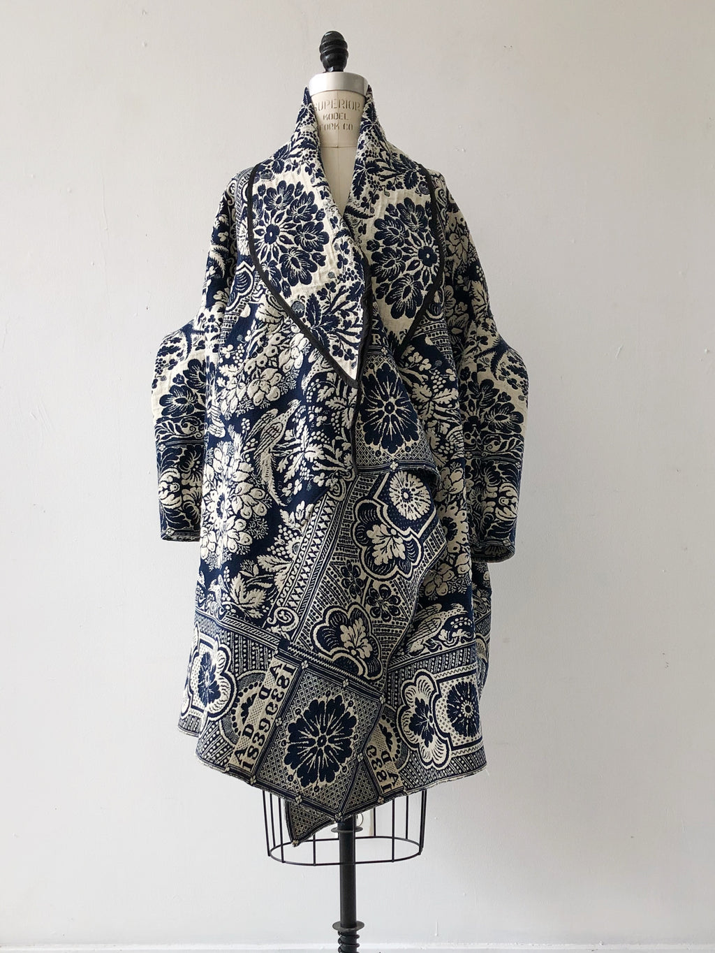 1839 coverlet cocoon with hood