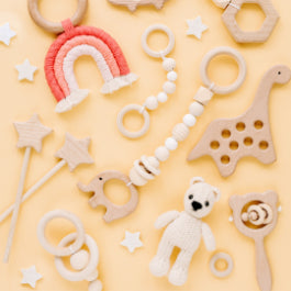 Collombatti Naturals Sustainable Gifts Guide to Help You Shop with a Conscience Blog - an array of wooden toys on a yellow background