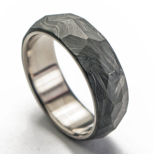 Forged carbon fiber ring with titanium