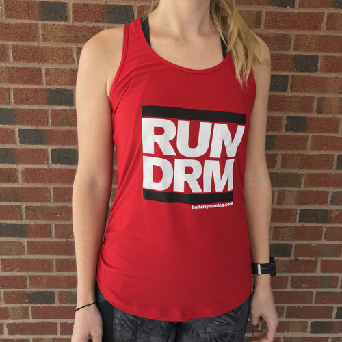 New Balance Transform Perfect Tank in red with black/ white RUN DRM logo.