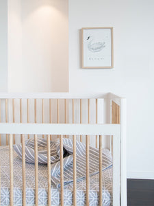 White Babyhood cot beds in all white nursery with grey strip bedsheets | Not Too Big