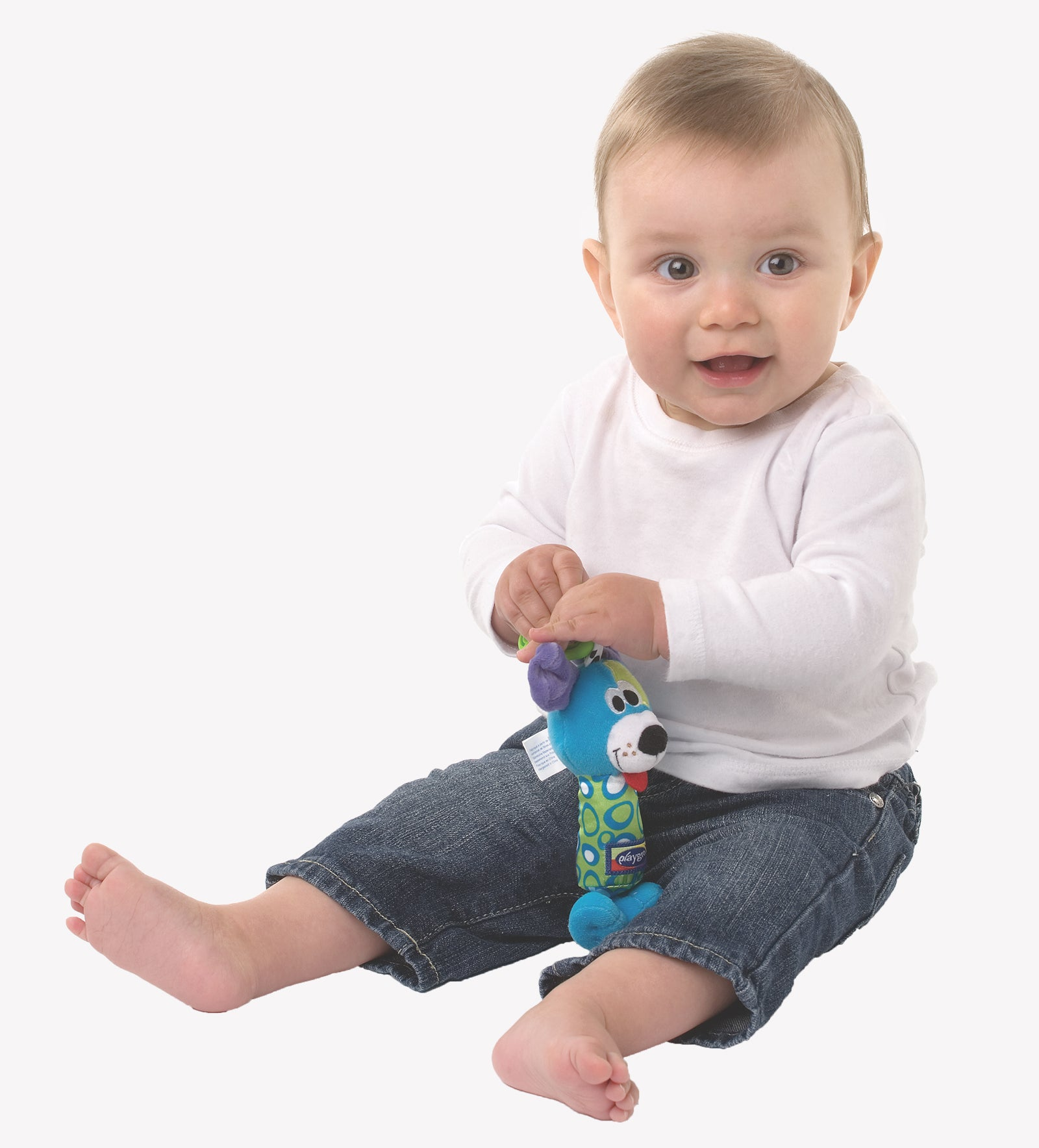 A baby boy holding PLaygro Tinker Toy on his hand