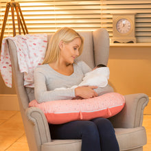 Load image into Gallery viewer, Mother hugging baby in the [Clevamama] ClevaCushion Nursing Pillow & Baby Nest - Not Too Big (Coral)