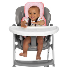 Load image into Gallery viewer, Baby sitting in a high chair with the [Clevamama] ClevaCushion Nursing Pillow & Baby Nest - Not Too Big (Coral)