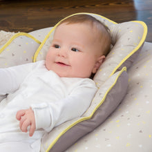Load image into Gallery viewer, Baby smiling in the [Clevamama] Grey/Yellow ClevaCushion Nursing Pillow & Baby Nest - Not Too Big