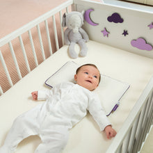 Load image into Gallery viewer, Baby sleeping on the [Clevamama] ClevaFoam Baby Pillow in a baby cot - Not Too Big