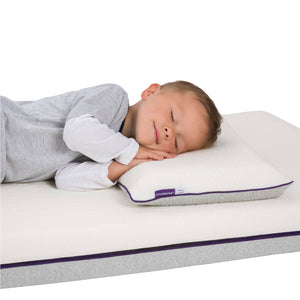 Child lying on the [Clevamama] ClevaFoam Toddler Pillow - Not Too Big