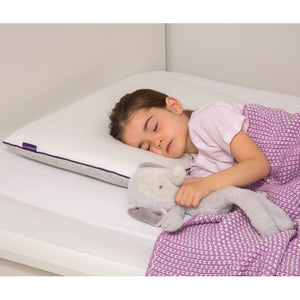 little girl sleep on Clevamama junior pillow and her plush toy