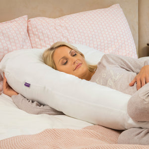 Mother lying in the [Clevamama] Therapeutic Body & Bump Maternity Pillow - White - Not Too Big