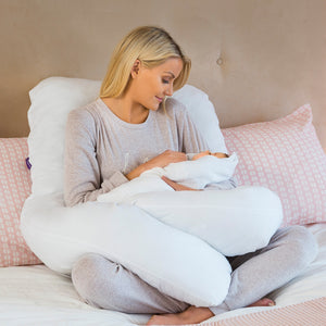 Mother hugging baby while being supported by the [Clevamama] Therapeutic Body & Bump Maternity Pillow - White - Not Too Big