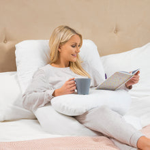 Load image into Gallery viewer, Mother reading and chilling in the [Clevamama] Therapeutic Body & Bump Maternity Pillow - White - Not Too Big