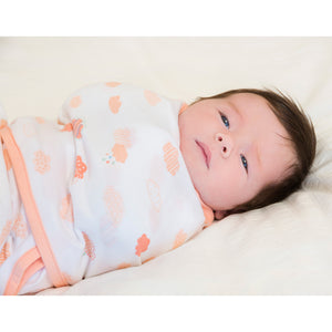 Baby swaddled in the [Clevamama] Clevamama Swaddle to Sleep (0-3 months) - Not Too Big