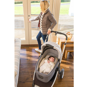 Mother bringing baby out in the baby cot with the [Clevamama] ClevaFoam Head & Body Support - Grey/Yellow - Not Too Big