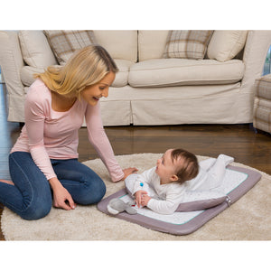 Mother and baby playing in the [Clevamama] Newborn Tummy Time Mat - Not Too Big