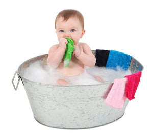 Baby in a bucket of water with our [Mum2Mum] Face Washers Brights 6 Pack - Not Too Big