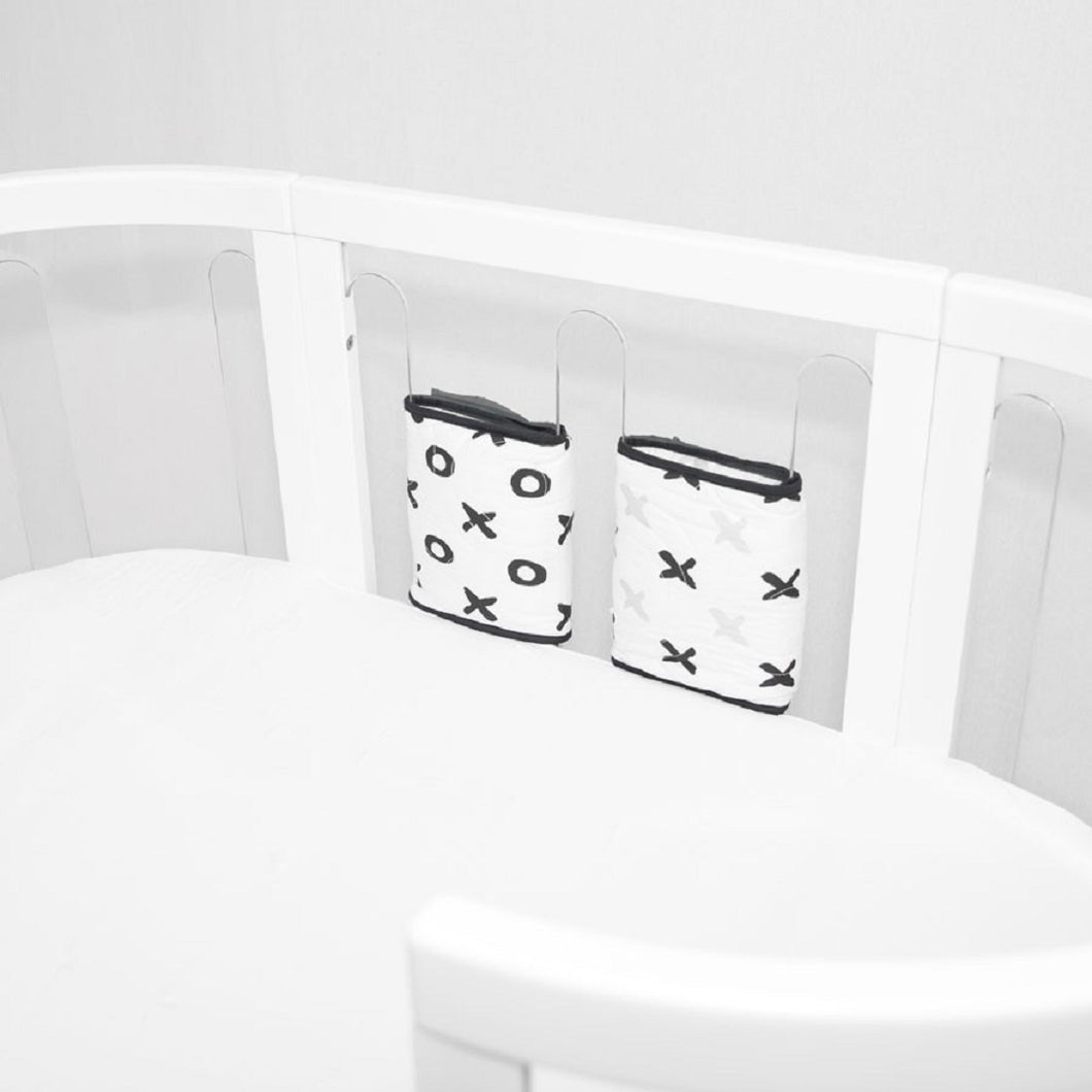 Babyhood cotbed bumper with tic tac toe design placed on Kaylula cotbed