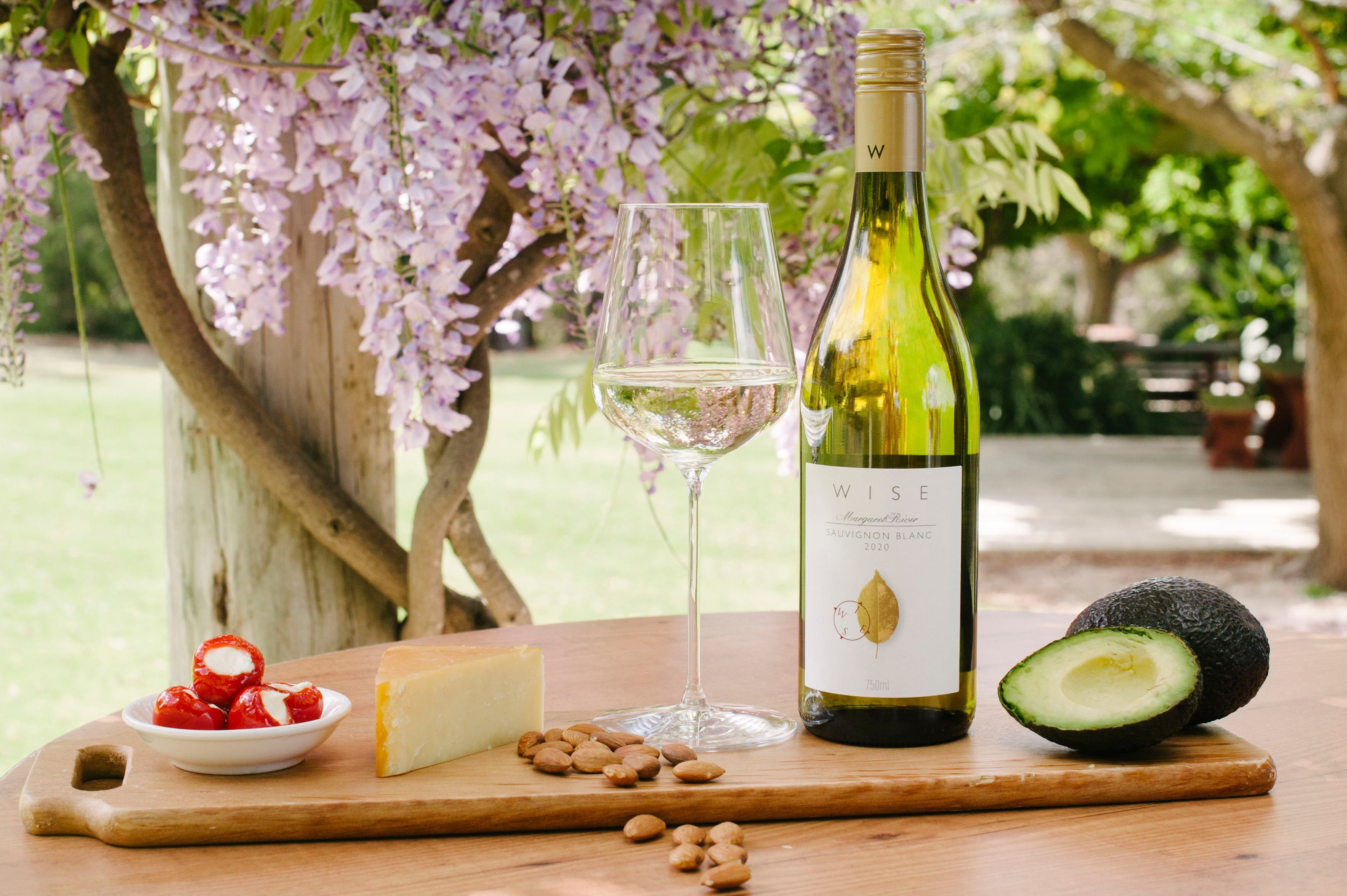 glass of white wine with tasting platter