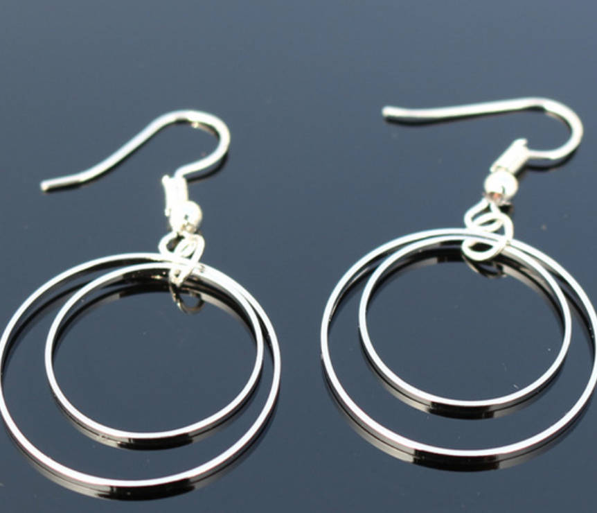 geometric silver circular dangle earrings elegant simplistic earrings
