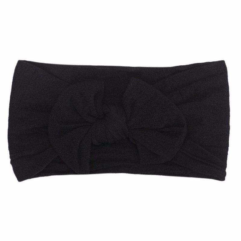 black headband bow laid flat