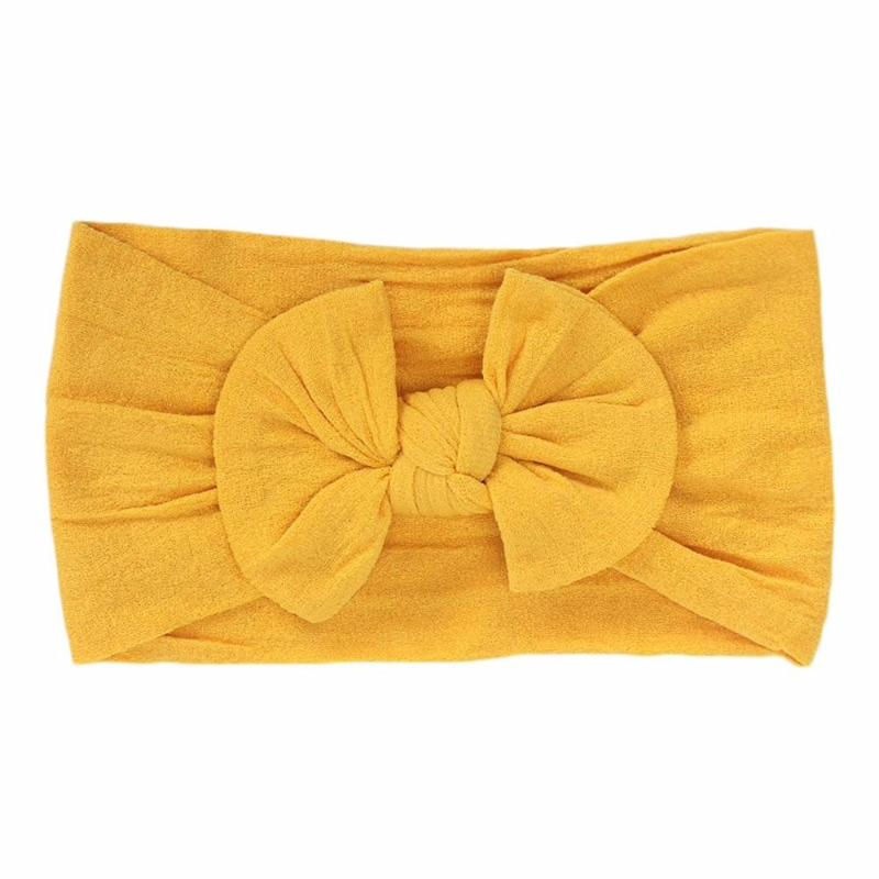maize colored headband bow laid flat