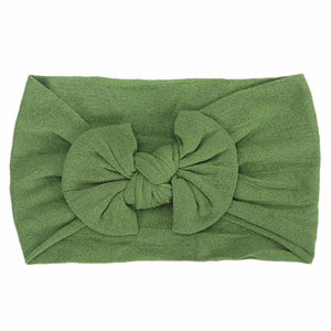 green headband bow laid flat