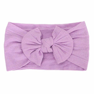purple headband bow laid flat