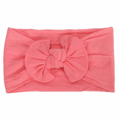 watermelon red colored headband bow laid flat