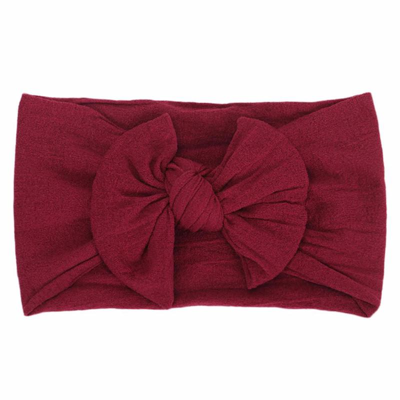 wine colored headband bow laid flat