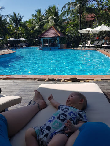 baby near pool in vietnam family holiday