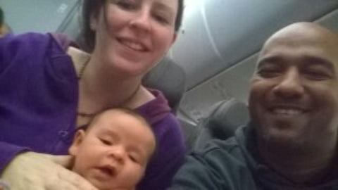 newborn baby on plane with parents
