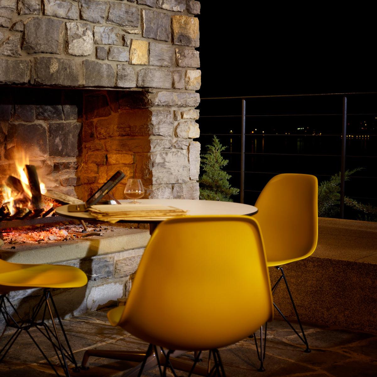 Vitra Eames Plastic Side Chair DSR Powder Coated for Outdoor Use. Outdoor Fire Setting