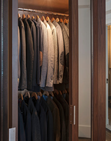 sportcoats on wooden hangers